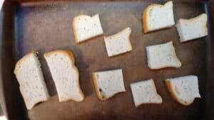 For the Farr Better Easy Bruschetta Recipe use a non-toxic baking sheet and get 7 slices of gluten-free bread. Cut the bread into 1/4's. Place evenly on a baking sheet.