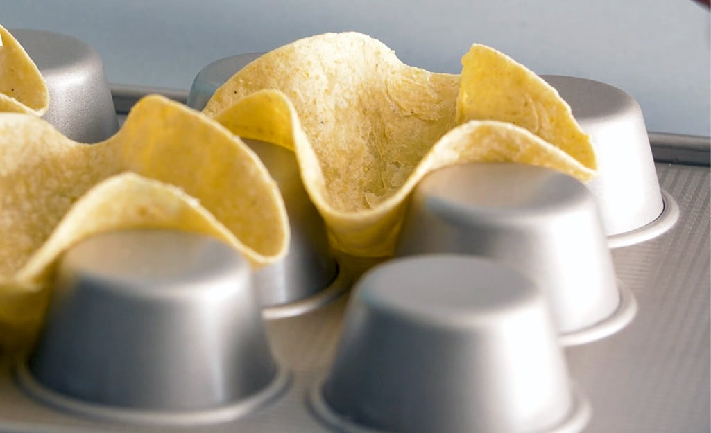 Home Depot helps show us other ways to use a muffin tin to make mini tortilla shells