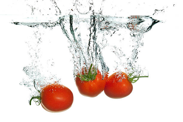 Wash tomatoes thoroughly with Earth's Natural Fruit & Vegetable Wash