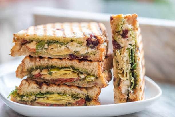 Stacked Vegetarian Sandwiches of Arugula Artichoke sun Dried Tomato